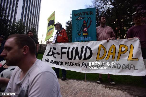 Protesters stand in solidarity with the 'Native Nations Rise' march on Washington DC against the construction of the Dakota Access Pipeline in...