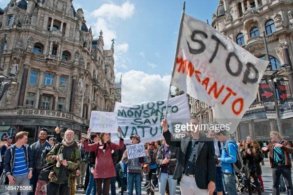 Protesters stand on the Meir in Antwerp on May 25 2013 during a protest against the American multinational agricultural biotechnology corporation...