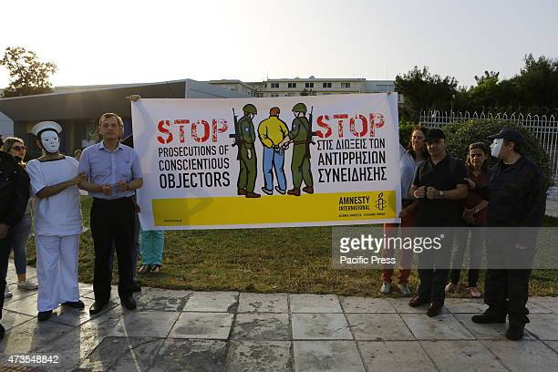 SQUARE ATHENS ATTICA GREECE Protesters stand outside the Ministry of Defense calling for an end of the prosecution of conscientious objectors...