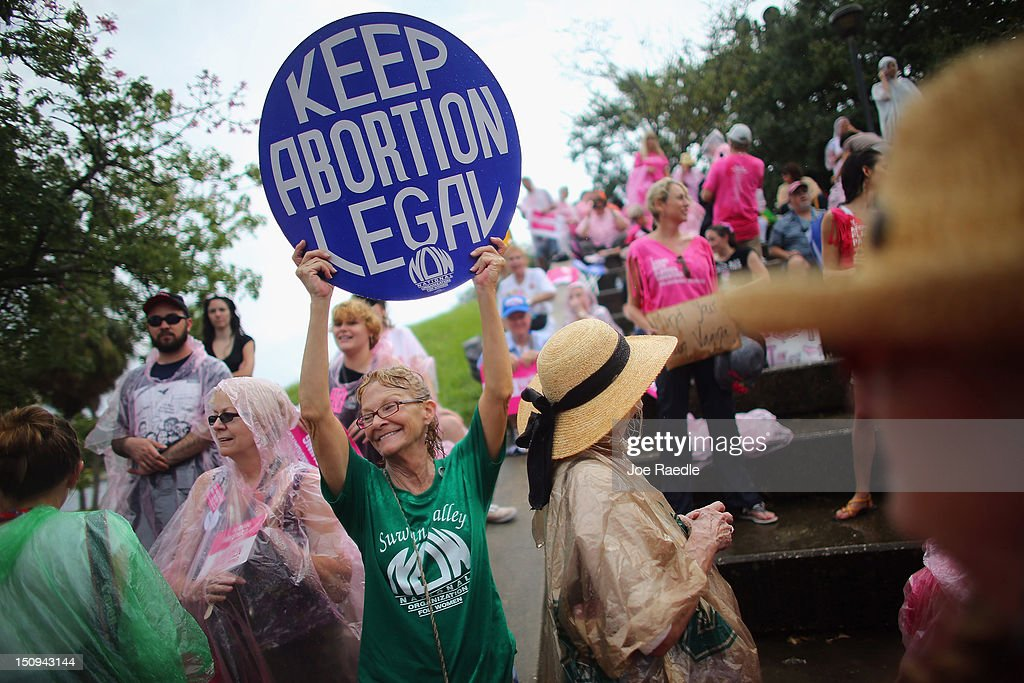 Protesters stand together during a Planned Parenthood rally as the Republican National Convention continues on August 29, 2012 in Tampa, Florida. The Republican party delegates affirmed Mitt Romney as the party's nominee for president August 28.