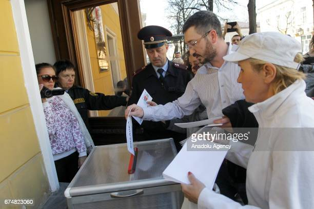 Protesters submit their letters demanding Russian President Vladimir Putin not to run for a fourth term for Presidential elections in Kazan Russia on...