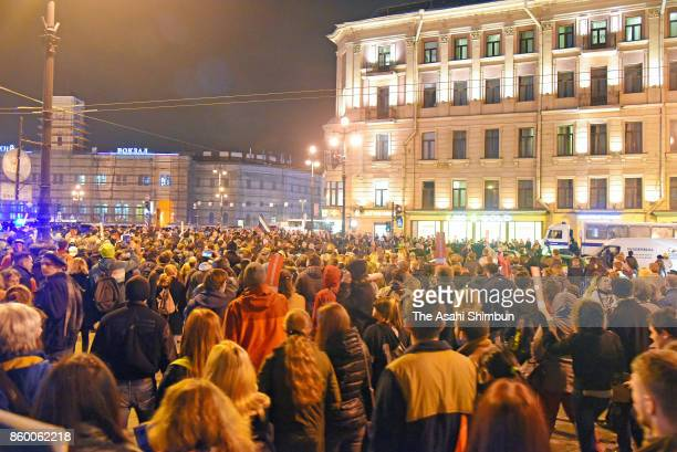 Protesters supporting Alexei Navalny hold a rally on Russian President Vladimir Putin's 65th birthday on October 7 2017 in Saint Petersburg Russia