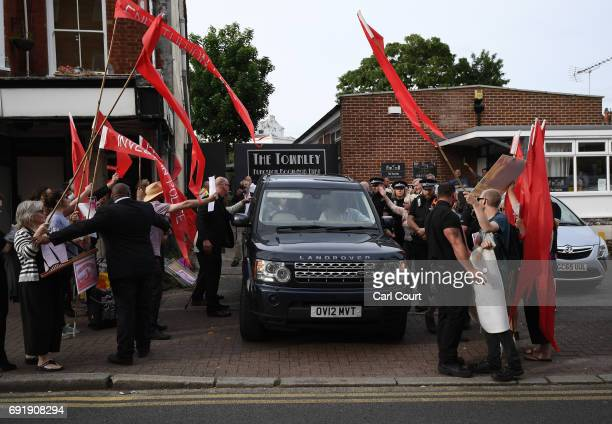 Protesters surround former UKIP leader Nigel Farage's car as he leaves the rally on June 3 2017 in Ramsgate England All parties continue to push the...