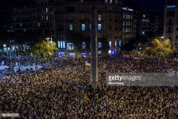 Protesters take part in a candlelit vigil to demand the release of imprisoned seperatist leaders Jordi Sanchez head of the Catalan National Assembly...