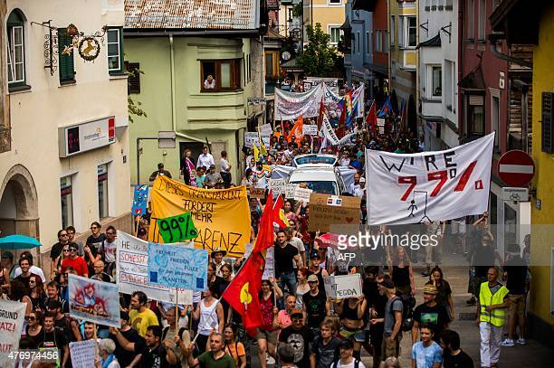 Protesters take part in a demonstration against the Bilderberg conference in Telfs Austria on June 13 2015 The Bilderberg group which brings together...
