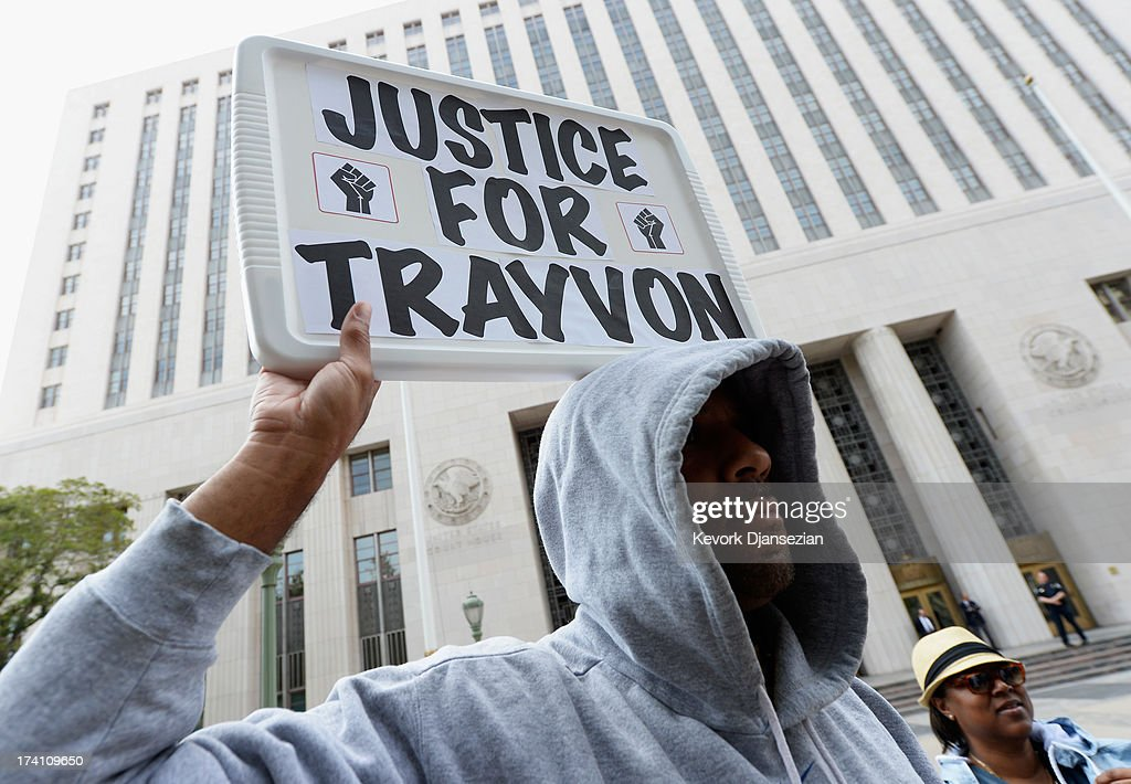 Protesters take part in a 'Justice for Trayvon' vigil outside Los Angeles Federal Courthouse July 20, 2013 in Los Angeles, United States. The vigil, along with others held nationwide, was organized by the National Action Network and called for federal charges to be filed against George Zimmerman in the shooting death of teenager Trayvon Martin.