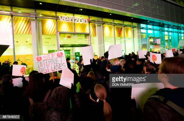 Protesters take part in a Net neutrality rally at a Verizon store December 7 2017 in New York Demonstrations in support of net neutrality are planned...