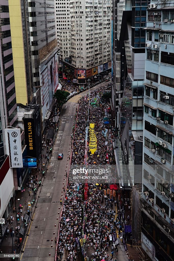 Protesters take part in a rally in Hong Kong on July 1, 2016, to mark the 19th anniversary of the former British colony's handover to China. Protesters marched in Hong Kong on July 1 to mark the anniversary of the city's handover from Britain to China, with pro-independence groups rallying for the first time amid fears Beijing is tightening its grip. / AFP / Anthony Wallace