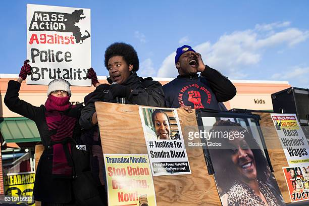 Protesters take part in a rally in support of a minimum wage of $15/hour and an end to police violence against minorities in Boston on Jan 18 2016