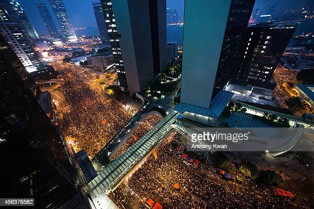 Protesters take part in a rally on a street outside of Hong Kong Government Complex on September 30 2014 in Hong Kong Thousands of pro democracy...