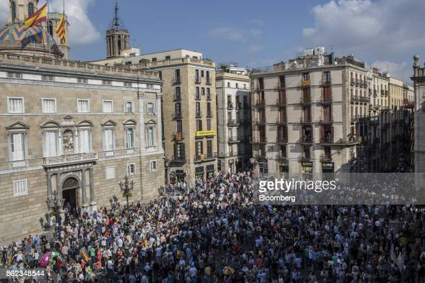Protesters take part in a silent demonstration outside the Generalitat in support of arrested Catalan independence campaigners Jordi Sanchez and...