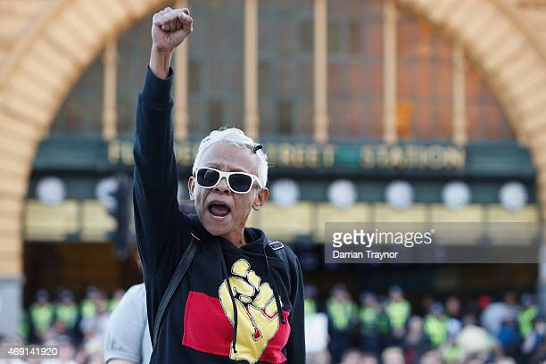 Protesters take part in a traditional smoking ceremony at the intersection of Swanston and Flinders street on April 10 2015 in Melbourne Australia...