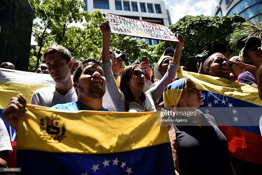 Protesters take part in an anti-government demonstration outside the Supreme Tribunal of Justice (TSJ) in Caracas, Venezuela on May 25, 2016. Protesters seeking to drive Venezuela's President Nicolas Maduro from office launched fresh street rallies.