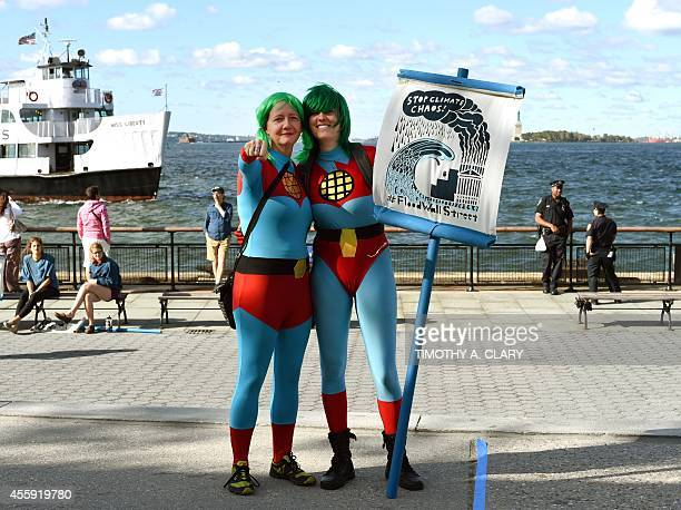 Protesters take part in the 'Flood Wall Street' demonstrations and march on September 22 2104 in lower Manhattan preceding the United Nations's...