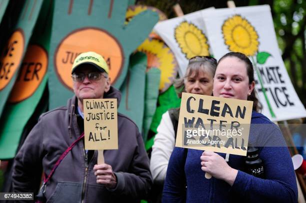 Protesters take part in the People's Climate March in Portland Ore United States on April 29 2017 Thousands turned out in solidarity with actions in...