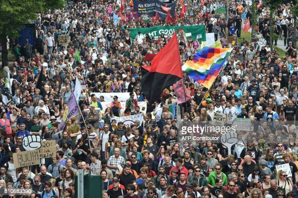 Protesters take part in the 'solidarity without borders instead of G20' demonstration on July 8 2017 in Hamburg northern Germany as world leaders...