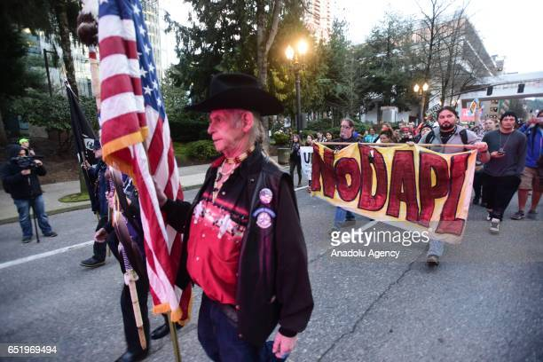 Protesters take to the streets in a show of solidarity with the 'Native Nations Rise' march on Washington DC against the construction of the Dakota...