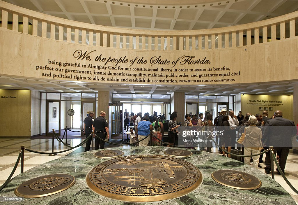Protesters take turns screening through security prior to their meeting with Florida Governor Rick Scott concerning the shooting of unarmed teen...