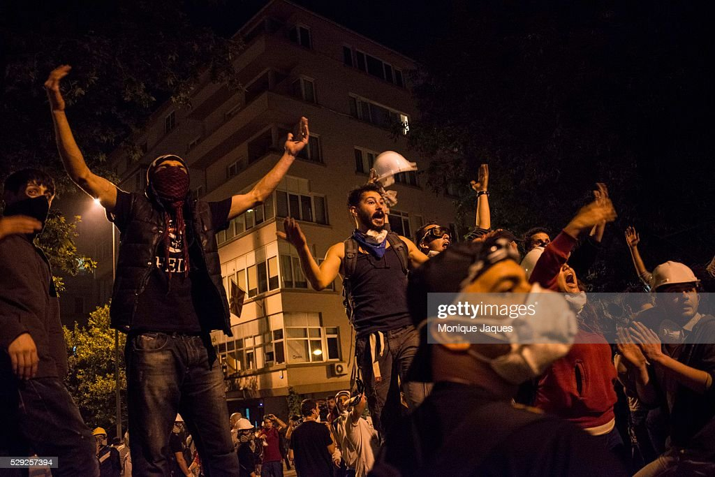 Protesters taunt the police helicoptors that fly above Protests in Istanbul Turkey continue into the night Protests began as a fight to save Gezi...