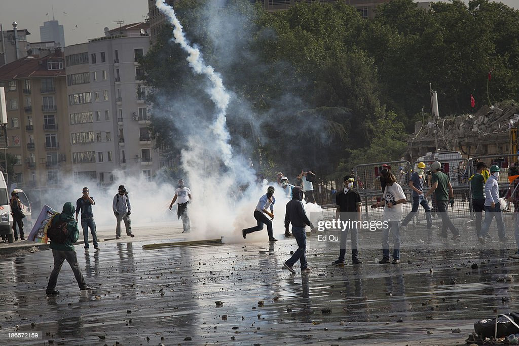 Protesters throw tear gas fired from police in Takism Square in Istanbul Turkey on June 11 2013 Hundreds of police entered Taksim Square this morning...