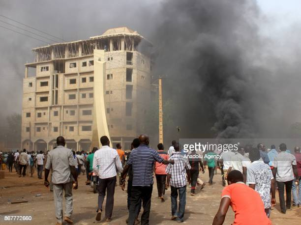 Protesters try to block the road as they stage a protest against government's budget law of 2018 in Niamey Niger on October 29 2017