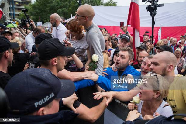 Protesters try to break through a barrier guarded by Policemen in front of the Sejm building in Warsaw Poland on 20 July 2017 People protest against...