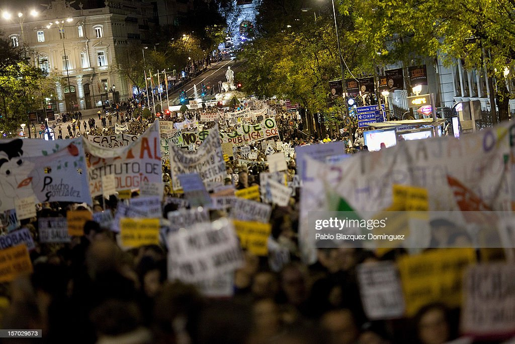 Protesters walk along Alcala Street with health workers during a demonstration held on the second day of a two day general strike on November 27, 2012 in Madrid, Spain. For the first time all trade unions call for a 48 hours health workers general strike in Madrid Region after Regional Government anounced severe cuts and privatization of Medical Centers.