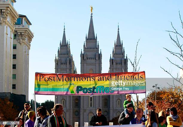 Protesters walk past the historic Mormon temple after many submitted their resignations from the Church of Jesus Christ of LatterDay Saints in...