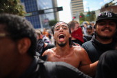 Protesters walk together through the streets on the first full day of the Republican National Convention at the Tampa Bay Times Forum on August 28...