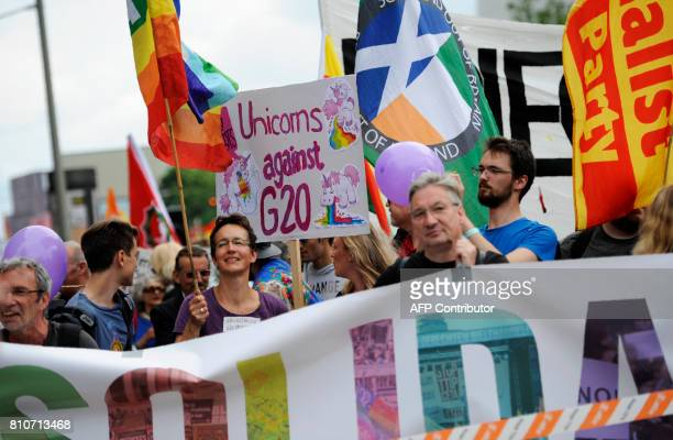 protesters walk with banners during the 'Solidarity without borders instead of G20' demonstration on July 8 2017 in Hamburg northern Germany as world...