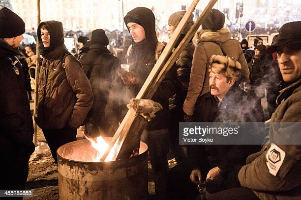 Protesters warming up themselves on Maidan Square on December 11 2013 in Kiev Ukraine Thousands have been protesting against the Ukrainian government...