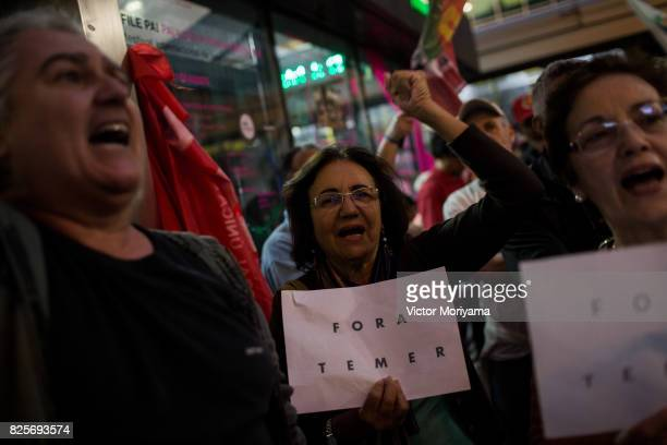 Protesters watch television on corruption trial against President Michel Temer in front of the Office of the Presidency of the Republic on August 2...
