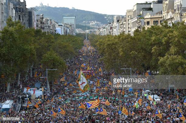 TOPSHOT Protesters wave Catalan proindependence Estelada flags during a demonstration in Barcelona on October 21 2017 in support of two leaders of...
