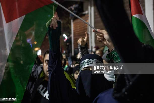 Protesters wave flags and shout slogans outside the US Consulate on December 6 2017 in Istanbul Turkey People gathered to protest after US President...