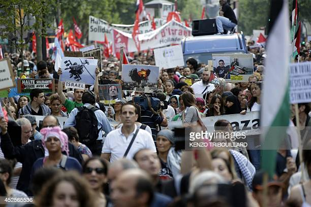 Protesters wave flags and signs during a demonstration on July 23 2014 in in Paris to denounce Israel's military campaign in Gaza and to show their...
