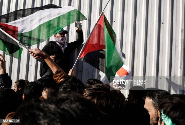 Protesters wave Palestinian flags during a demonstration against the US president's recognition of Jerusalem as Israel's capital in Istanbul on...