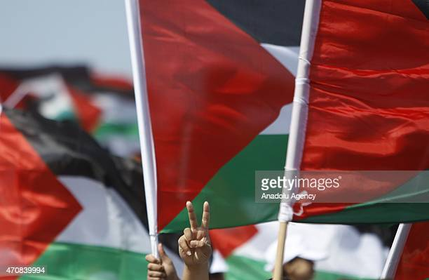Protesters wave Palestinian flags during the Nakba Day an annual day of commemoration of the displacement that preceded and followed the Israeli...