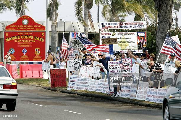 Protesters wave signs in support of the United States military during a protest at the front gate of Camp Pendleton June 24 2006 in Oceanside...
