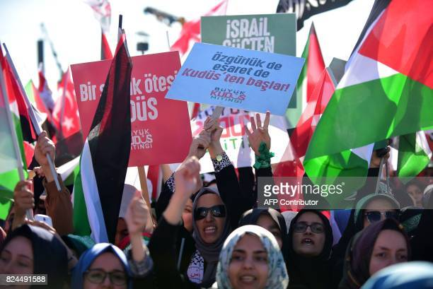 Protesters wave Turkish and Palestinian flags and hold up a placard reading 'Liberty and captivity starts in Jerusalem' during a demonstration in...