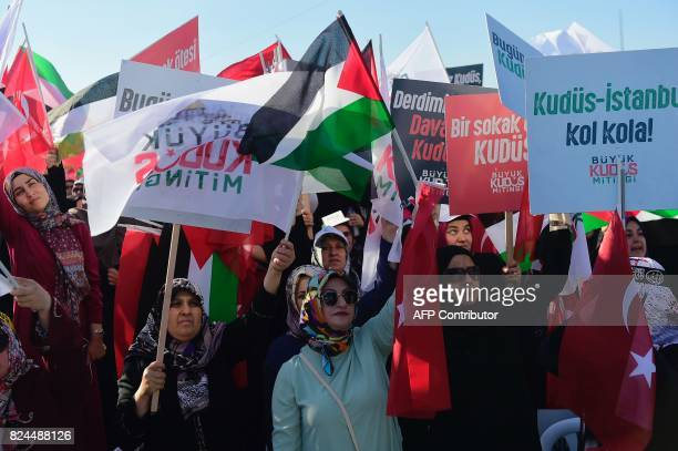 Protesters wave Turkish and Palestinian flags as they hold placards reading 'Jerusalem Istanbul shoulder to shoulder' during a demonstration in...