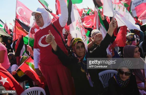 Protesters wave Turkish and Palestinian flags during a demonstration in Istanbul on July 30 to protest against measures taken by Israel in Jerusalem...