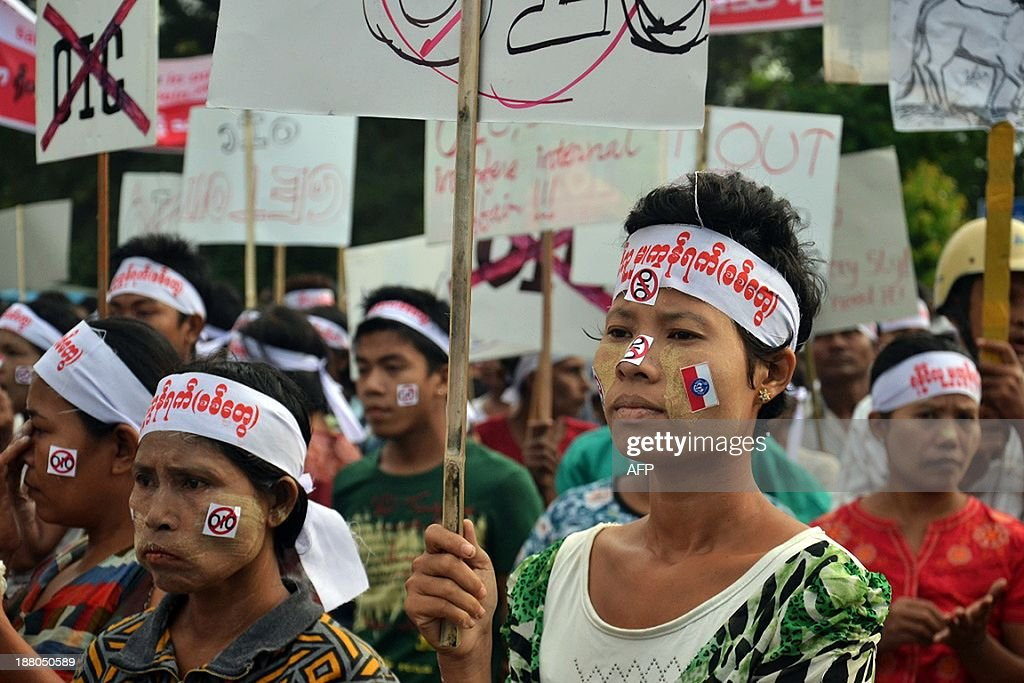 Protesters wear headbands and anti-OIC stickers as they stage a demonstration against a visit by members of the Organisation of Islamic Cooperation (OIC) in Sittwe, Myanmar's western Rakhine state on November 15, 2013. Myanmar Buddhist monks led rallies against the Organisation of Islamic Cooperation as delegates from the Muslim body toured western Rakhine state, where religious violence has torn communities asunder. The delegation from the world's top Islamic body is in the country to discuss the response to several bouts of anti-Muslim violence that have left some 250 people dead and tens of thousands homeless.