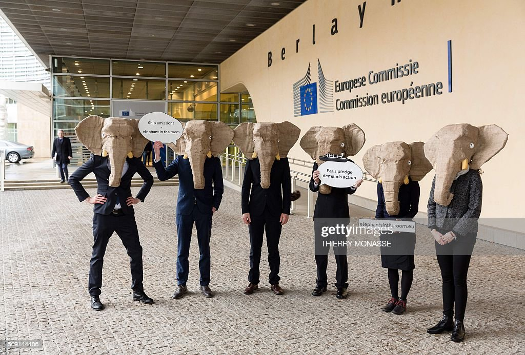 Protesters wearing elephant masks demonstrate to demand European Union and International Maritime Organisation take more action on cutting shipping emissions in front of the Berlaymont, the European Council headquarters in Brussels on February 9, 2016. AFP PHOTO / THIERRY MONASSE / AFP / THIERRY MONASSE