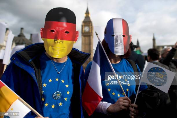 TOPSHOT Protesters wearing German and French flag face masks pose for a photograph during a 'Flag Mob' demonstration in Parliament Square in central...