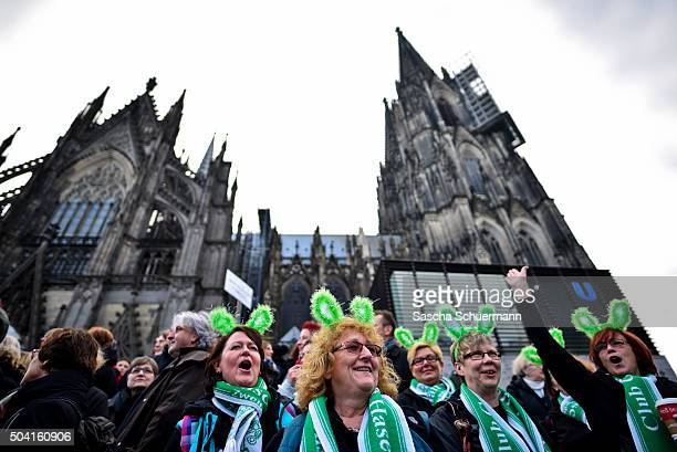 Protesters wearing green rabbit ears gather in front of Cologne Cathedral next to Hauptbahnhof main railway station to protest against the New Year's...