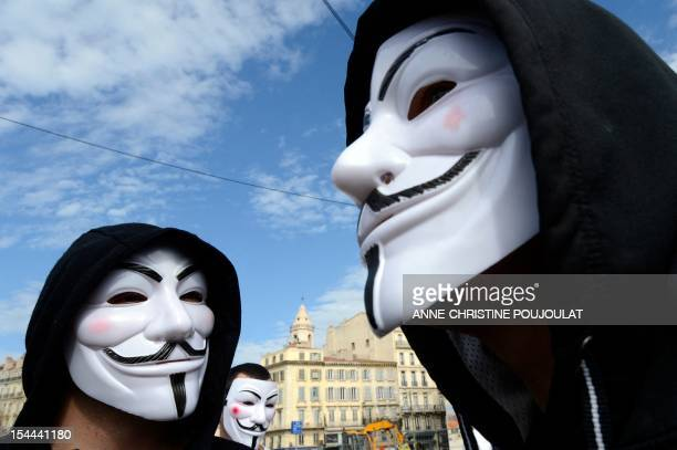 Protesters wearing Guy Fawkes masks take part in a march of the 'Anonymous' mouvement to protest against the European Intelligent information system...