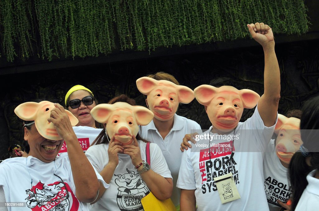 Protesters wearing pig masks chant as they call on the Philippine government to abolish the Priority Development Assistance Fund (PDAF), more commonly known as the pork barrel fund on September 11, 2013 in Manila, Philippines. Protesters took to the streets of Manila today following the court's ruling on the so called 'Pork Barrel Fund', a discretionary fund in the Philippines available to members of Congress.