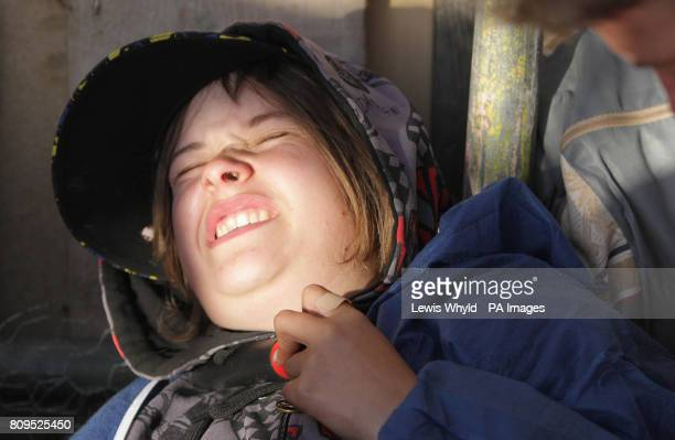 A protesters who has chained herself by the neck to the entrance of the Dale Farm travellers site at Cray's Hill near Basildon Essex where bailiffs...