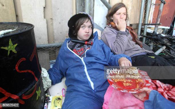Protesters who have chain themselves to the entrance at the Dale Farm travellers site at Cray's Hill near Basildon Essex where bailiffs will later...