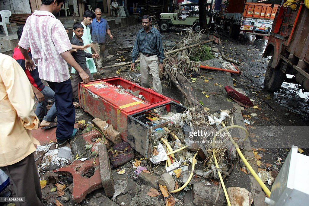 Protesters who staged Rasta Roko at Kurla, against the contaminated water and no electricity for 5 days, showing the condition of electric transfarmer box in Kurla on July 30, 2005 in Maharashtra, India. Kurla is the worst hit by the flood.
